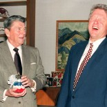 US President-elect Bill Clinton (r) breaks into a