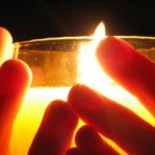 candle and hands